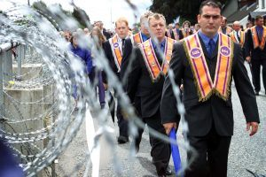 ORANGEMEN PARADE TO THE SECURITY BARRIER AT DRUMCREE CHURCH.