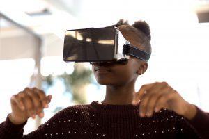 Young girl using virtual reality glasses